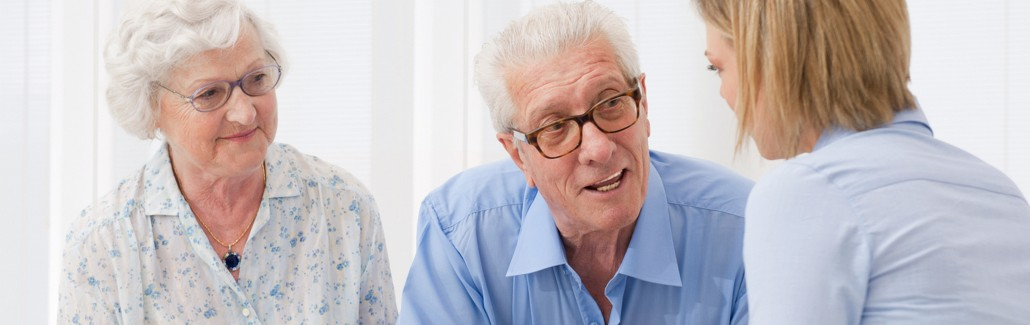 Elderly couple meeting advisor about aged care assistance.